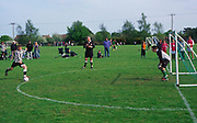 AF5GM5 Children's football tournament. View of goalkeeper and striker shooting with referee watching. Penalty shoot out.