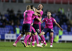 Queens Park Rangers's Toni Leistner (2nd left) celebrates with his team mates after he scores their side's first goal of the game during the Sky Bet Championship match between Reading and Queens Park Rangers.