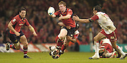Cardiff, WALES.  Munster's Trevor Halsted passes the ball as he is tackled, during the  2006 Heineken Cup Final,  Millennium Stadium,  between Biarritz Olympique and Munster,  20.05.2006. © Peter Spurrier/Intersport-images.com,  / Mobile +44 [0] 7973 819 551 / email images@intersport-images.com.   [Mandatory Credit, Peter Spurier/ Intersport Images].14.05.2006   [Mandatory Credit, Peter Spurier/ Intersport Images].