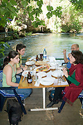 Turkey, Antalya, Upper Duden River A family at a fish restaurant on the river front. Model Release Available