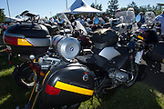 A BMW GS motorcycle fitted with a homemade external fuel tank mounted on the back passenger seat.