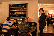 New York, NY, - December 8, 2013. Barbara Lambert, co-owner with her husband, chef Matt Lambert, talking to diners in the dining room of The Musket Room, 265 Elizabeth St.