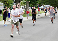 Middletown, New York - Runners race to the finish line in the 15th annual Ruthie Dino Marshall 5K Run and Fun Walk hosted by the Middletown YMCA on Sunday, June 5,  2011.