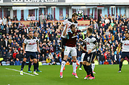 Eric Dier of Tottenham Hotspur jumps highest and clears the ball. Premier League match, Burnley v Tottenham Hotspur at Turf Moor in Burnley , Lancs on Saturday 1st April 2017.<br /> pic by Chris Stading, Andrew Orchard sports photography.