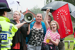Anti EDL demonstrators should UAF slogans at EDL members holding a rally in Hexthorpe Doncaster South Yorkshire on Saturday. The EDL and UAF are thought to have chosen Hexthorpe after recent media reports of tension between newly arrived Roma residents and the the local community<br /> 18 July 2014<br /> Image © Paul David Drabble <br /> www.pauldaviddrabble.co.uk