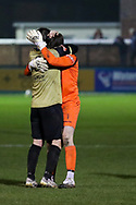 Marine forward Niall Cummins (9) and Marine goalkeeper Bayleigh Passant (1) celebrate winning during the The FA Cup match between Marine and Havant & Waterlooville FC at Marine Travel Arena, Great Crosby, United Kingdom on 29 November 2020.