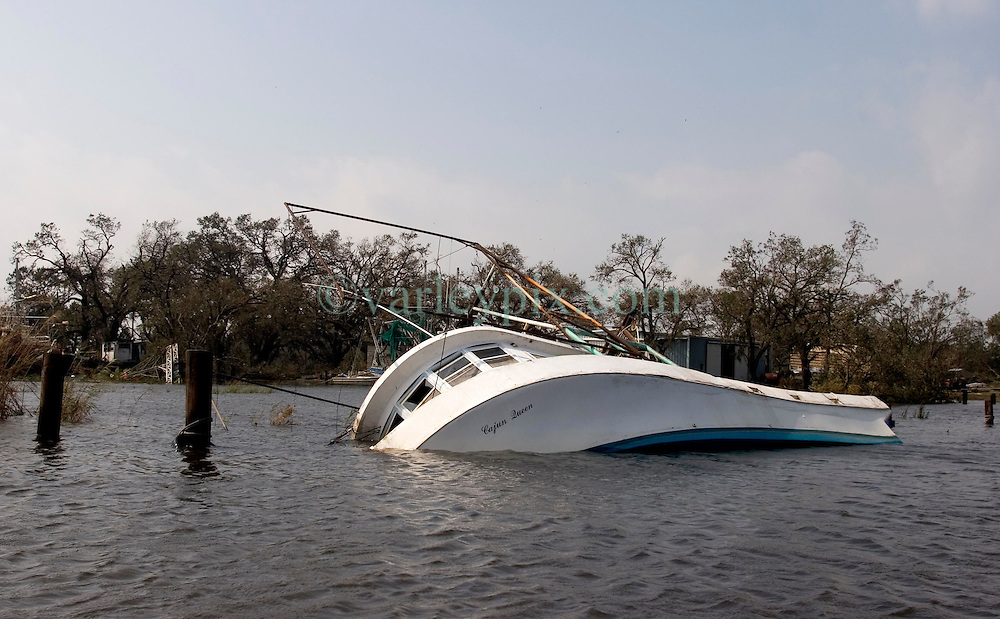 25 Sept, 2005. Lake Calcasieu, Louisiana.  Hurricane Rita aftermath. <br /> Lake Calcasieu shipping canal close to Cameron, Louisiana one day after the storm smashed the coastline. The shrimp boat the 'Cajun Queen' lies sunk in the town of Hackberry.<br /> Photo; ©Charlie Varley/varleypix.com
