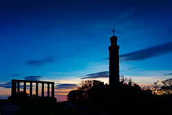 Edinburgh, Scotland, UK. 21 October 2020. Nelson Monument on Calton Hill is silhouetted against morning sunrise sky on Trafalgar Day in Edinburgh. Iain Masterton/Alamy Live News