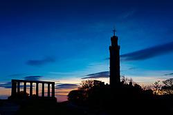 Edinburgh, Scotland, UK. 21 October 2020. Nelson Monument on Calton Hill is silhouetted against morning sunrise sky on Trafalgar Day in Edinburgh. Iain Masterton/Alamy Live News
