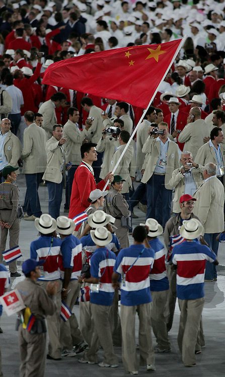 8/13/04 --Al Diaz/Miami Herald/KRT--Athens, Greece--Opening Ceremony in the Olympic Stadium at the Athens Olympic Sports Complex on Friday. Yao Ming leads the Hong Kong Chinese delegation furing Opening Ceremony.