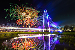 Fireworks over Margaret Hunt Hill Bridge, Trinity River, Dallas, Texas, USA.