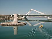 A motor boat passes below the famous Sheikh Zayed Bridge.