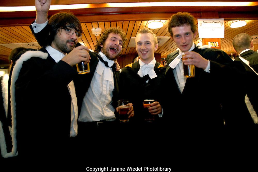 Graduating Students drinking at the bar Cambridge University Graduation Day