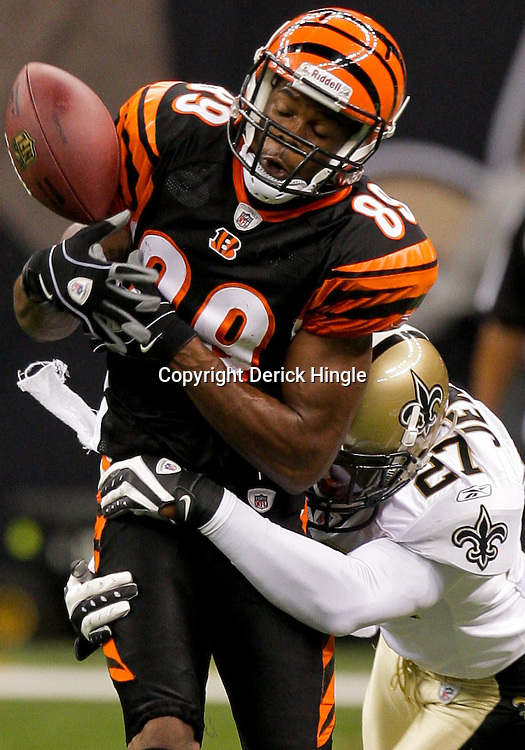 2009 August 14: New Orleans Saints cornerback Malcolm Jenkins (27) hits Cincinnati Bengals wide receiver Jerome Simpson (89) forcing the ball into the air where it was intercepted by linebacker Jonathan Casillas (not pictured)during 17-7 win by the New Orleans Saints over the Cincinnati Bengals in their preseason opener at the Louisiana Superdome in New Orleans, Louisiana.