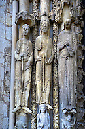 .West Facade, Left Portal c. 1145,  Cathedral of Notre Dame, Chartres, France. Gothic statues of three elongated jamb statues are on the left side of the left portal. All have canopies and stand on figural bases. All hold books or scrolls. Their height increases from left to right. Note the figured columns between them.. A UNESCO World Heritage Site. . .<br /> <br /> Visit our MEDIEVAL ART PHOTO COLLECTIONS for more   photos  to download or buy as prints https://funkystock.photoshelter.com/gallery-collection/Medieval-Middle-Ages-Art-Artefacts-Antiquities-Pictures-Images-of/C0000YpKXiAHnG2k