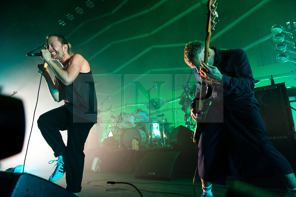 © Licensed to London News Pictures. 24/07/2013. London, UK.   Thom Yorke (L) and Flea ® of Atoms for Peace performing live at The Roundhouse. Atoms For Peace is an experimental rock & electronic supergroup formed in late 2009 in Los Angeles, California. The group consists of Radiohead lead singer Thom Yorke (vocals, guitar, and piano), Red Hot Chili Peppers bassist Flea, longtime Radiohead producer Nigel Godrich (keyboards, synths, guitars), Joey Waronker of Beck & R.E.M. (drums) and Brazilian instrumentalist Mauro Refosco (percussion) of Forro in the Dark. Their debut album, Amok, was released on February 25, 2013.   Photo credit : Richard Isaac/LNP
