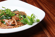 Vegetarian Stir fried noodles garnished with greens