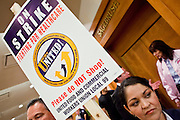 Nov. 11, 2009 -- PHOENIX, AZ: JENNIFER ARVALLO, an employee of Frys', with her picket sign during a meeting of members of the UFCW at the Airport Marriott Hotel in Phoenix. The United Food and Commercial Workers Union (UFCW) Local 99 has about 25,000 members in Arizona: 15,000 in Fry's grocery stores and Fry's Marketplace, 9,500 in Safeway stores and 400 in Smith's grocery stores. The union voted down the last proposal from the stores and has announced plans to go on strike at 6PM on Friday, Nov. 13. The meeting Wednesday is the last one before the strike.   Photo by Jack Kurtz