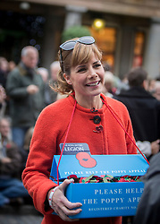 © Licensed to London News Pictures. 07/11/2013.  Strictly Come Dancing judge Darcy Bussell CBE was out today collecting for the Poppy Appeal in Covent Garden as part of London Poppy Day.  The dance stars joined service personnel to help the charity raise one million pounds in the capital today.  Photo credit: Alison Baskerville/LNP