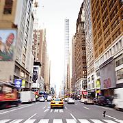 Yellow Cab driving fast in Manhattan street