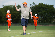 """Frisco Wakeland High School football coach Marty Secord  wears his Nike gear during practice in Frisco, Texas on August 23, 2016. """"CREDIT: Cooper Neill for The Wall Street Journal""""<br /> TX HS Football sponsorships"""