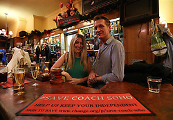 Landlord of the Coach And Horses in Soho, London Alastair Choat and his daughter Hollie hosting London's first nudist pub singalong.