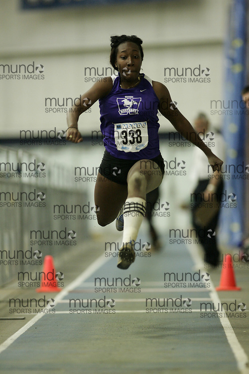 (Windsor, Ontario---13 March 2010) Alicia Smith of University of Western Ontario Mustangs  competes in the women's triple jump at the 2010 Canadian Interuniversity Sport Track and Field Championships at the St. Denis Center. Photograph copyright GEOFF ROBINS/Mundo Sport Images. www.mundosportimages.com