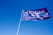 03 SEPTEMBER 2020 - RADCLIFFE, IOWA: A campaign flag for Donald Trump flies over a corn field in central Iowa. Although Iowa's rural economy is struggling because of poor export sales for crops, a loss of about 30% of the corn crop because of a derecho wind storm, and a persistent drought, Donald Trump is still popular with many farmers.        PHOTO BY JACK KURTZ