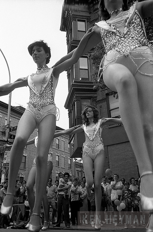 Hipshot- with camera on the ground showing a festival on Atlantic Avenue in Brooklyn.
