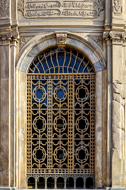Exterior detail of bronze window grilles and carved marble reliefs at the Sabil wa Kuttab of Tusun Pasha, the elder son of Muhammad Ali Pasha