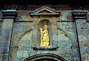 France, Normandy.  Granville. Ext. Eglise Notre-Dame showing erosion of statue.