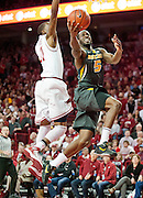Feb 16, 2013; Fayetteville, AR, USA; Missouri Tigers guard Keion Bell (5) drives to the basket past Arkansas Razorbacks guard BJ Young (11) during a game at Bud Walton Arena. Arkansas defeated Missouri 73-71. Mandatory Credit: Beth Hall-USA TODAY Sports