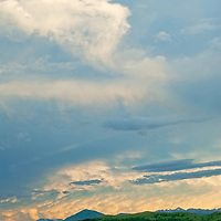 A sunset lights clouds lover Montana's Story Hills, Gallatin Range, and the  Spanish Peaks.