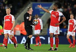 Fleetwood Town's Nathan Pond disputes the VAR decision after Leicester City's second goal with referee Jon Moss
