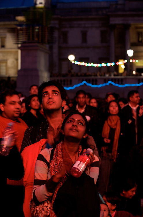 London.  October 19, 2008.  Hiten Mistry, 19, and Navadini Vijajkumar, 18, who performed the opening act, enjoy the dancing during the Diwali, festival of lights, celebrations. Thousands of Londoners gathered at Trafalgar Square on Sunday for Diwali, which has religious significance for Hindus, Sikhs and Jains, and is celebrated by many communities throughout the capital.  Dances of many styles including Kathak from North India, Oddissi dancers from Orissa, classical Bharata Natyam, contemporary dance, and a touch of Bhangra were performed.   The event was organised by the Mayor of London and the National Gallery of Art.  (Photo by Mark Bryan Makela/UPPA/Photoshot)