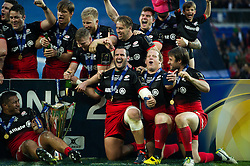 Juan Figallo and Petrus Du Plessis of Saracens celebrate after the match - Mandatory byline: Patrick Khachfe/JMP - 07966 386802 - 14/05/2016 - RUGBY UNION - Grand Stade de Lyon - Lyon, France - Saracens v Racing 92 - European Rugby Champions Cup Final.