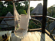 A lounge chair hangs from the inside of an observation tower, Napo Wildlife Center, Amazon, Ecuador.