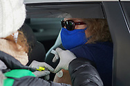Ruth Overmohle, of Schnecksville, receives a shot of the Moderna vaccine during a COVID-19 drive-through vaccination clinic put on by Lehigh Valley Health Network on Jan. 27, 2021, at Dorney Park in Allentown, Pennsylvania. Community members 75 and older were eligible to receive their first dose with an appointment ahead of time. (Photo by Matt Smith)