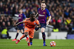 March 13, 2019 - Barcelona, Catalonia, Spain - March 13, 2019 - Barcelona, Spain - Uefa Champions League 1/8 of final second leg, FC Barcelona v Olympique de Lyon: Ndombele challenges for the ball against Ivan Rakitic of FC Barcelona. (Credit Image: © Marc Dominguez/ZUMA Wire)