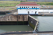 Miaflores Lock, Panama Canal, Panama, April 2014, Lock full of water one side, Sequence 13 of 13 In the Miraflores locks, vessels are lifted (or lowered) 54 feet (16.5 m) in two stages, allowing them to transit to or from the Pacific Ocean port of Balboa in Panama City. Ships cross below the Bridge of the Americas, which connects North and South America.