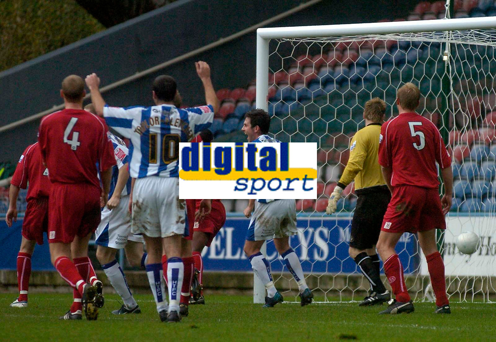 Photo: Glyn Thomas.<br />Huddersfield Town v Welling United. The FA Cup. 06/11/2005.<br />Huddersfield's Andrew Booth's header beats Welling keeper Jamie Turner (second from R).