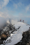 Alaska. Cook Inlet. Mount Augustine Crater, overlooking Cook Inlet on a high adventure skiing trip down the side of a volcano. Where Fire meets Ice.
