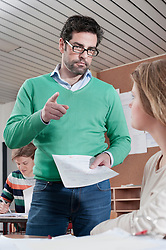 Teacher scolding student because of her bad result in classroom, Bavaria, Germany