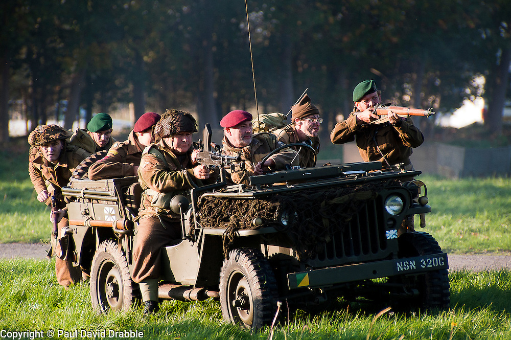 Reenactors portraying British paratroops of the 6th airborne division with a willys jeep take part in a battle reenactment on the Pickering show ground October 2011<br /> © Paul David Drabble