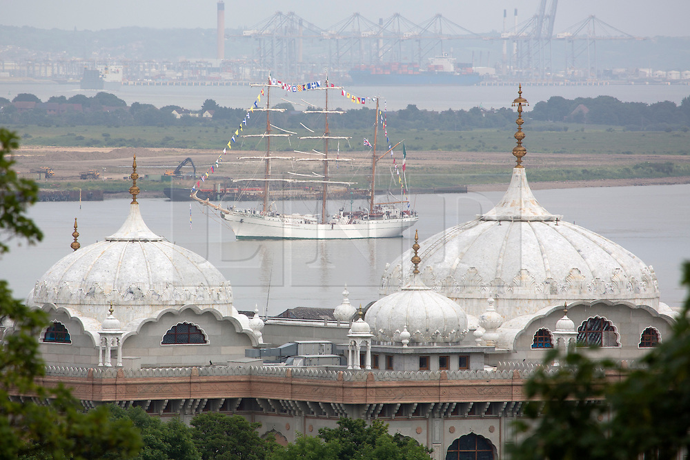 © Licensed to London News Pictures. 07/06/2016. The Mexican Navy's Sail Training Ship ARM Cuauhtemoc has arrived on the Thames for a port visit which will see her open to the public in West India Docks this weekend.  Tall ship seen passing a Sikh temple at Gravesend. Credit: Rob Powell/LNP