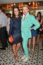 ROSANNA FALCONER and HENRY CONWAY at Henry Conway's 31st birthday party held at the Pont St Restaurant, Belgraves Hotel, London on 12th July 2014.
