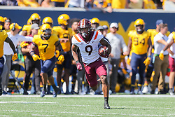 Sep 18, 2021; Morgantown, West Virginia, USA; Virginia Tech Hokies wide receiver Tayvion Robinson (9) catches a pass and runs for extra yards during the first quarter against the West Virginia Mountaineers at Mountaineer Field at Milan Puskar Stadium. Mandatory Credit: Ben Queen-USA TODAY Sports