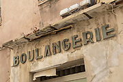 Crumbling facade of the boulangerie in the centre on 16th September 2017 in Bastia, Corsica, France. Bastia is a French commune in the Haute-Corse department of France located in the north-east of the island of Corsica at the base of Cap Corse. Bastia is the principal port and commercial town of the island. The inhabitants of Bastia are known as Bastiais or Bastiaises.