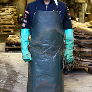 Santa Croce Sull'Arno, Italy. Bonistalli & Stefanelli SPA, hides and skins tanning. .Portrait of a worker in the unrefined hides department.