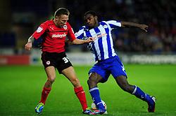 Cardiff City's Craig Bellamy is tackled by Sheffield Wednesday's Michail Antonio - Photo mandatory by-line: Dougie Allward/Josephmeredith.com  - Tel: Mobile:07966 386802 01/12/2012 - SPORT - FOOTBALL - Championship  -  Cardiff  -  New Cardiff Stadium  -  Cardiff City V Sheffield Wednesday